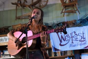 Claudia Stark playing at Weyfest Rustic Stage 2015, Taylor Guitars