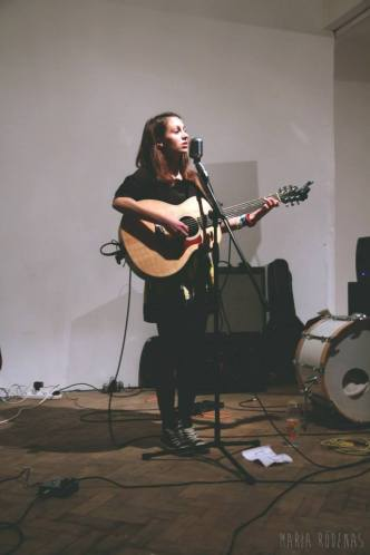 Claudia Stark playing at Stoke Newington Studios London, Taylor Guitars